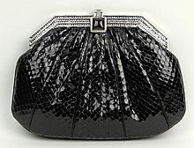 Judith Leiber New York Snakeskin and Silver Tone Hardware with Inset Rhinestone Evening Bag. Signed. Missing a Couple of Rhinestones Otherwise Good Condition or Better. Measures 6-7/8 Inches tall and 9 Inches Wide. Shipping $38.00