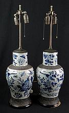 Pair of 19th Century Chinese Porcelain Crackle Glaze Vase/Lamps. Each Very Nicely Detailed With Birds, Butterflies and Flora. Vases have Surface Wear Consistent with Age. Wood Bases Have Paint Loss Otherwise in Good Condition. Each Vase Measures 16