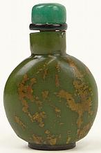 19th Century Chinese Green Glass Snuff Bottle Emulating Jade with Green Jade Stopper. Unsigned. From the Collection of a Founding Member of the International Chinese Snuff Bottle Society. Please Examine This Lot Carefully Before Bidding. We are