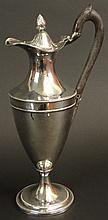 George III Style English Silver Plate Wine Jug with Wooden Handle. Unsigned. No Monogram. Copper Showing Through in Spots or else Good Condition. Measures 12-1/2 Inches Tall and 6 Inches Long. Shipping $40.00