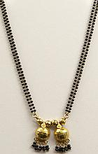 Antique 18 Karat Yellow Gold and Black Onyx Colored Glass Beaded Lady's Necklace. Unsigned. Good to Very Good Condition. Measures 37 Inches Long and the Pendant/Drop Part Measures 1-5/8 Depending on how you Measure it. Gross Weight Approximately