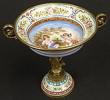 Early 20th Century Vienna Enamel Miniature Compote with Painted Cherubs and Figural Stem. Unsigned. Very Good Condition. Measures 2-7/8 Inches Tall and 3-1/4 Inches Wide. Shipping $28.00