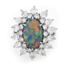 Vintage Tiffany & Co Oval Cabochon Black Opal, Pear Shape and Round Brilliant Cut Diamond and Platinum Ring