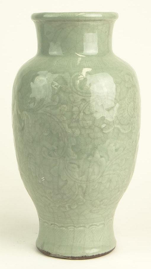 Antique Chinese Celadon Porcelain Vase with Crackle Glaze and Floral Decoration Surrounding the Vase. Unsigned. Restoration and Chip to Foot, Spider Vein Glaze Cracking or else Good Condition. Measures 11 Inches Tall and about 6 Inches Diameter.