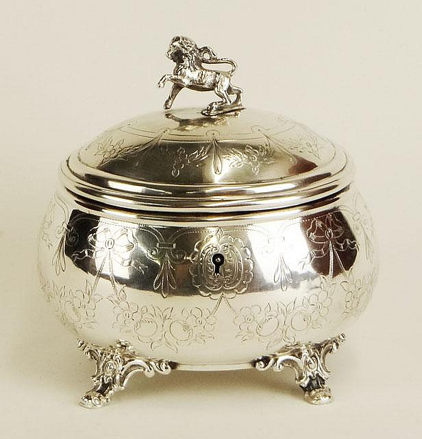 Antique Austrian 0.800 Continental Silver Footed Vanity Box with Lion Finial and Nicely Etched Decoration. Signed with Hallmarks and Has Makers Mark WH. Circa 1867-1922. Good to Very Good Condition. Sans Key. Weighs 11.146 Troy Ounces. Measures 5-1/4