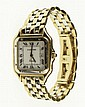 Man's 14 Karat Yellow and White Gold Mid-Size Quartz Movement Tank Style Wrist Watch with Date Function. Bears Cartier Signature, Swiss Movement on Dial and 14K, 0.585 Rear of Case. Scratching, Rubbing from Use or else Good Condition. Weight: 47.0