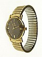 Mid 20th Century 14 Karat Goldfilled Omega Seamaster Deville Automatic Man's Wristwatch. Dial Signed Omega, Automatic, Seamaster and Deville. Rear of Case Signed 14 Karat Gold Filled. Band Signed Speidel. Very Good Condition and Running Condition.