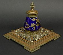 19th/20th Century Bronze and Hand Painted Enamel Porcelain Inkwell. Bronze Pineapple Finial Mounted on a Hinged Lid Surmounted above a Gilt Hand Painted Floral Design Porcelain Inkwell with a Cobalt Blue Ground, Insert Mounted into a Open Pierced and