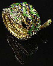Fabulous Vintage Italian Hand Made 18 Karat Yellow Gold and Enamel Articulated Snake Bracelet Accented with Round Brilliant Cut Diamonds and Marquise Cut Ruby Eyes. Signed 18K Italy. Diamonds F-G Color, VS1-VS2 Clarity. Good to Very Good Good