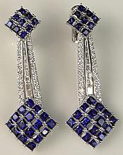 Fabulous Pair of Lady's 11.15 Carat Square Cut Sapphire, 1.55 Carat Round Brilliant Cut Diamond, 1.25 Carat Tapered Baguette Cut Diamond and 18 Karat White Gold Drop Ear Clips. Sapphires with Vivid Saturation of Color, Diamonds E-F Color, VS Clarity.