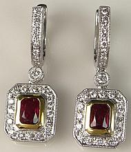 Finely Made Pair of Lady's 2.1 Carat Emerald Cut Ruby, .90 Carat Round Brilliant Cut Diamond and 18 Karat Yellow and White Gold Earrings. Rubies with Vivid Saturation of Color, Diamonds E-F Color, VS Clarity. Signed 18K 750. Very Good Condition.