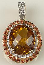 Lady's Sima K Oval Cut Citrine, Round Brilliant Cut Diamond and 14 Karat Yellow Gold Pendant en suite with the Previous Lot. Signed. Very Good Condition. Measures 1 Inch Long and 5/8 Inch Wide. Approx. Weight: 3.25 Pennyweights. Shipping $26.00
