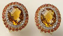 Pair of Lady's Sima K Oval Cut Citrine, Round Brilliant Cut Diamond and 14 Karat Yellow Gold Earrings. Signed. Very Good Condition. Measure 5/8 Inch Tall and 1/2 Inch Wide. Approx. Weight: 5 Pennyweights. Shipping $26.00