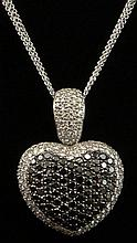 Lady's Approx. 4.75 Carat Total Weight Invisible Set Black and Micro Pave Set Round Brilliant Cut Diamond and 18 Karat White Gold Heart Pendant Necklace. Round Brilliant Cut Diamonds E-F Color, VS Clarity. Signed 18K, 750. Very Good Condition.