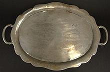 Large Heavy Taxco Sterling Silver Footed Tray with Handles. Marked Taxco Made in Mexico 925. Surface Wear and Scratches Consistent with Use Otherwise in Good Condition. Weighs 88.019 Troy Ounces. Measures 2 Inches Tall by 27 Inches Long and 18 inches