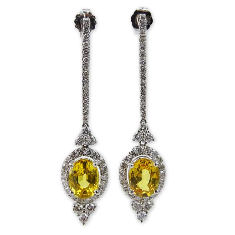 3.20 Carat Oval Cut Yellow Sapphire, 2.30 Carat Round Brilliant Cut Diamond and 14 Karat White Gold Dangle Earrings