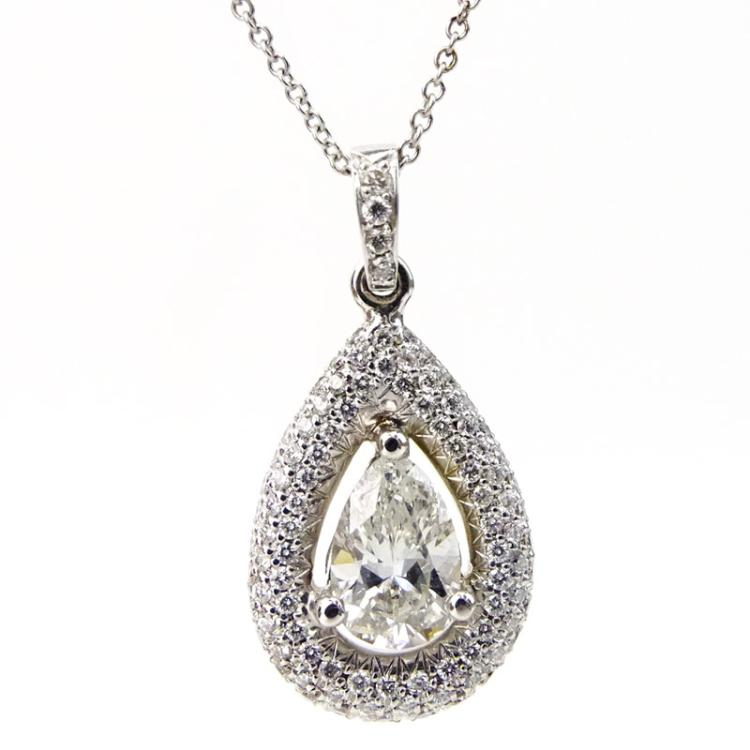 98 Carat Pear Shape Diamond and 18 Karat White Gold pendant accented with .54 Carat Round Brilliant Cut Diamonds and with 14 Karat White Gold Chain