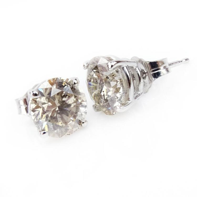 3.09 Carat Round Brilliant Cut Diamond and 14 Karat White Gold Ear Studs.