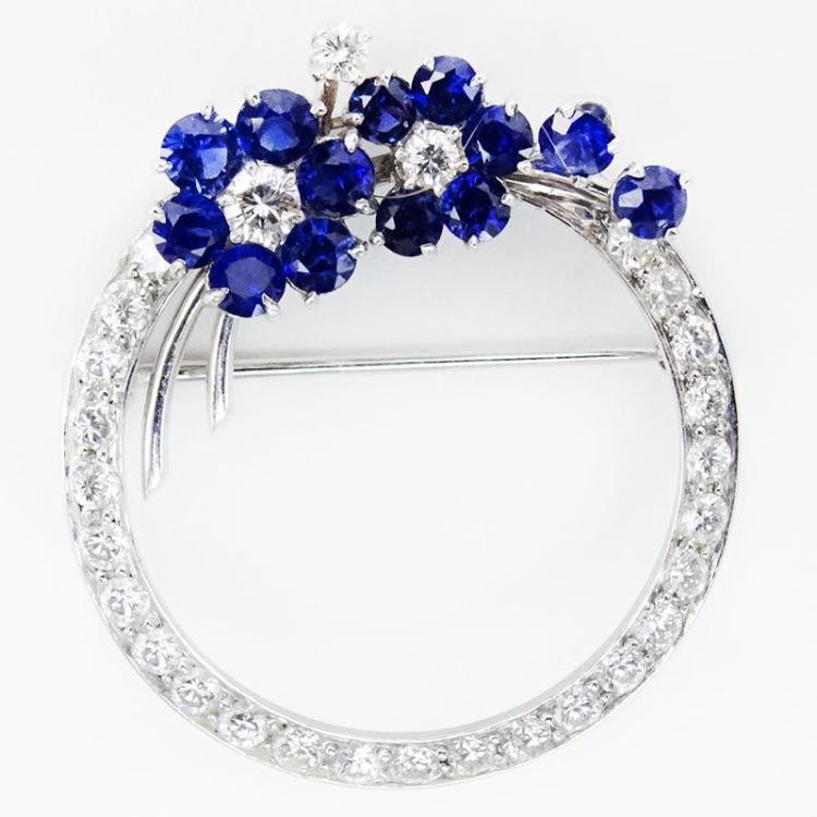 Circa 1940s Approx. .75 Carat Round Brilliant Cut Diamond, 1.50 Carat Sapphire and 18 Karat White Gold Circa Brooch.