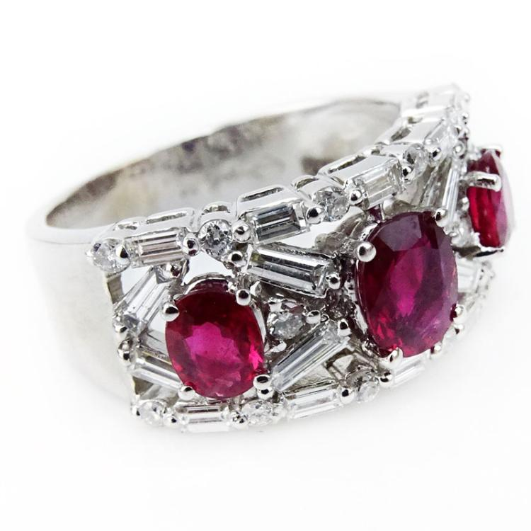 2.50 Carat Round Brilliant and Baguette Cut Diamond, Oval Cut Ruby and 18 Karat White Gold Ring.