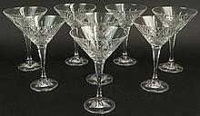 Set of Eight (8) Cut Crystal Martini Glasses. Unsigned. Chip to Rim of One Otherwise Good Condition. Measure 7 Inches Tall and 5 Inches Wide at Rim. Shipping $60.00