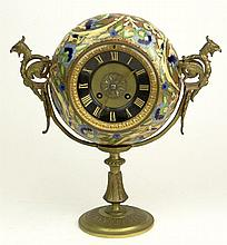 Early 20th Century French S. Marti et Cie Gilt Bronze and Enamel Clock with Wyvern Handles. Movement Signed. Lacking Key, No Confirmation of Running Condition, Crack to Enamel Otherwise Good Condition with Pendulum. Measures 12 Inches Tall and 11-1/2