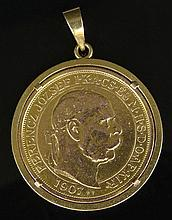 1907 Austrian 100 Korona Gold Coin Restrike Mounted as a Pendant with 18 Karat Yellow Gold Bezel. Bezel Signed 18K. Minor Surface Wear to Bezel from Normal Use, Coin Ungraded Minor Surface Wear. Measures 2-1/8 Inches Long and 1-5/8 Inches Diameter.