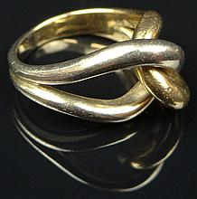Vintage 18 Karat White and Yellow Gold Knot Ring. Unsigned. Minor Surface Wear from Normal use Otherwise Good Condition. Ring Size 5-1/2. Approx. Weight: 6.45 Pennyweights. Shipping $26.00