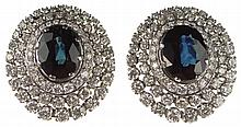Pair of Platinum Dark Blue Sapphire and Diamond Earrings. This Lovely pair features Center Stones of Dark Blue Sapphires, Approx. 12 Carats Total Weight. Surrounded by 3 Rows of Round Brilliant Diamonds of E-F Color and VS1-VS2 Clarity, Approx. 7.5