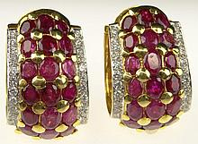 Handsome Pair of 18 Karat Yellow Gold, Ruby and Diamond Earrings. The Large pair features 20 Carats of High Quality Vivid Rubies of VS Clarity flanked by lines of 2.50 Carat Round Brilliant Cut Diamonds of E-F Color and VS1 Clarity. The earrings