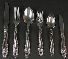 Twenty-Four (24) Piece Set Gorham Sterling Silver Flatware in the Décor Pattern. This Set includes: 4 Forks, 7-1/4 Inches; 4 Dessert Forks, 6-1/2 Inches; 4 Place Spoons, 7-1/4 Inches; 4 Teaspoons, 6 Inches; 4 Hollow Handled Knives, 9 Inches; 4 Hollow