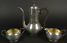Art Deco 1930's Gorham Silver After Dinner Coffee Set. Classic Motif with Gold Washed Interiors on both the open sugar and creamer. The Pot with Ebonized Wood Handle and Finial. All Pieces Marked with Gorham Hallmark. The Pot Measures 8-1/2 Inches