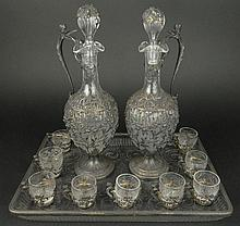 Circa 1892 Twelve Piece (12) Sterling Silver Overlay Crystal Cordial Service with Two Decanters, Nine Cordial Cups and Tray. Marked with English Lion Passant, Leopard Head and Date Mark 1892, French Minerva Mark and ETB Maker's Mark. Damage to One