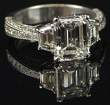 EGL Certified Platinum Diamond Engagement ring, consisting of one emerald step cut diamond weighing 2.08 Carats. Diamond is F-G Color and SI2 in clarity. Ring also contains seventy six (76) round brilliant and trapezoid Diamonds weighing 1.47 Carats