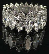 Platinum and Marquis Diamond Eternity Band. Set With approx. 9 Carats of Well Matched Marquis Diamonds of F-G-H Color and VS1-VS2 Clarity. Unsigned Size 4-1/2, Weighs Approx. 4.70 Pennyweights. Excellent Condition. Shipping $26.00