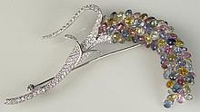 Vintage 18 Karat White Gold Tutti-Frutti Multi Colored Briolette Sapphire and Diamond Brooch. Lovely Floral Spray set with Approx. One Hundred Carats of Multi Colored Sapphires. Stem and Leaves set with Approx. 5 Carats Round Brilliant Diamonds of