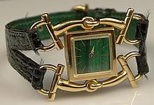 Rare Circa 1960's Gucci Lady's 18 Karat Yellow Gold Watch with Malachite Face and Crocodile Strap. Signed. Good Condition or Better with Original Box. Case Measures Approx. 1-1/2 Inches Tall and 1-1/8 Inches Wide, Strap Measures 7-1/2 Inches Long.