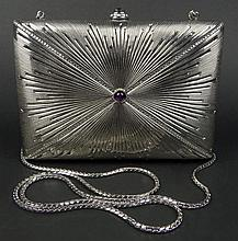 Retro Judith Leiber Silver Metallic Channel Crystal and Amethyst Cabochon Evening Purse With Shoulder Chain. Includes Original Hand Mirror, comb and coin purse. Silver Lame Lining. Original Dust Bag. Signed with Silver Tone Metal Tag on Inside. Very