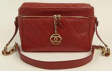 Large Unusual Chanel Red Leather Shoulder Bag. Gilt Hardware and Logo Charm. Signed Chanel. Has Original Chanel Carte D'Authenticite #1847068. Shows Minor Wear or else Good Condition. Measures 7-1/2 Inches Height by 12 Inches Long by 4-1/2 Inches