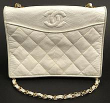 Retro Chanel Quilted White Leather Evening Bag with Snap Closure. White Leather Intertwined Gold Tone Shoulder chain. Original Dust Bag. Embossed Signature inside, Double C on Front Flap. Leather Lining. Good Gently Used Condition, Minor Scuffs.
