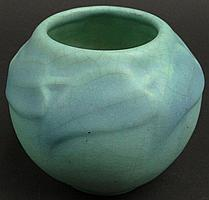 Circa 1918 Van Briggle Colorado Springs Pottery Squat Vessel Vase. Multi Toned Blue Matt Glaze. Incised Marked Van Briggle Colorado Springs. Some Crazing Otherwise in Very Good Condition. Measures 4 1/4 Inches Tall by 5-1/4 Inches Wide. Shipping