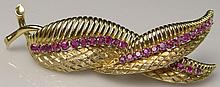 Retro Italian Ruby Mounted 18 Karat Yellow Gold Leaf Pin. Signed Italy, 18K. Good to Very Good Condition. Measures 2-1/2 Inches Long. Weighs 8.50 Pennyweights. Shipping $26.00