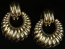 Pair of Italian 18 Karat Yellow Gold Drop Loop Ear Clips. Signed 750 and Possibly Maker's Mark. Good to Very Condition. Measure 1-3/4 Inches Long and 1-1/4 Inches Wide. Approximate Weight: 18.25 Pennyweights. Shipping $32.00