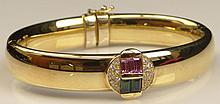 Lady's Vintage 18 Karat Yellow Gold, Diamond, and Pink and Green Tourmaline Hinged Cuff Bracelet en suite with the Previous Lot. Signed 750 and Maker's Mark to Clasp. Minor Surface Wear Otherwise Good Condition or Better. Measures Approximately 3/8