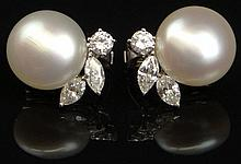 Pair of Lady's Vintage Approximately 2.5 Carat Total Weight Marquis Cut and Round Brilliant Cut Diamond, 18 Karat White Gold and White Baroque Pearl Ear Clips. Diamonds F-G Color, VS1-VS2 Clarity. Pearls Measures Approximately 15mm each Unsigned.