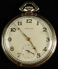 Circa 1930's Hamilton Art Deco 14 Karat Yellow Gold Pocket Watch with Leather Travel Pouch. Signed. Inscribed Presentation to an employee of the Packard Motor Car Company Dated 1934. Appears to be in Running Condition. Surface Wear from Normal Use