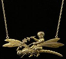 Late 19th Century Art Nouveau 14 Karat Yellow Gold and Diamond Putti Riding a Dragonfly. Signed 14K Three (3) Times. Good to Very Good Condition. Weighs 3.35 Pennyweights. Chain Measures about 15 Inches. Shipping $26.00