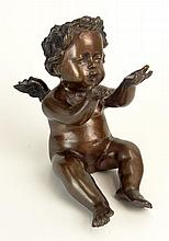 Decorative Modern Bronze Cherub Sculpture. Unsigned. Brown Patina, Loss to Finger. Measures 8-1/2 Inches Tall, 5 Inches Wide. Shipping $61.00