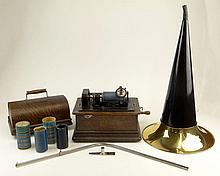Original Thomas Edison Standard Phonograph - Model D. Oak Case, Tin Horn. Includes 5 Rolls. Signed Thomas Edison Trade Mark, Original Metal Plate with Serial number 657 101. Good As Is Condition. Measures 11 Inches Tall, 12-1/2 Inches Width, 8-1/4