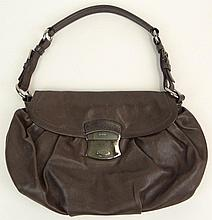 Prada Brown Leather Lady's Handbag with Silver Color Clasp. Has Original Prada Storage Bag. Signed Prada, Made in Italy. Good to Very Good Condition. Measures 8 Inches Tall by 12-1/2 Inches Wide Not Counting Strap. Shipping $30.00